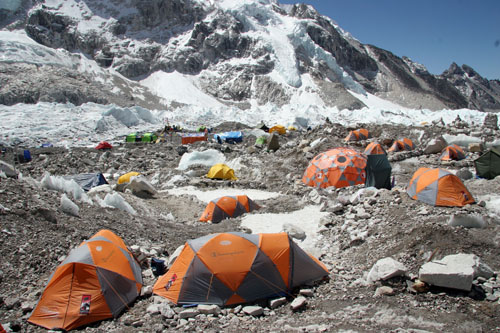 But my head was fuzzy and my pace was slow when we arrived. I found my tent and collapsed a nap at 17500 feet in the sky. & Thin Air: Essay on Everest Base Camp