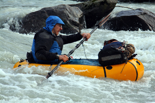 pack rafting in a rapid